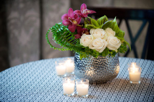 Elegant White, Pink, Green Floral Arrangement in Silver Container with Candles