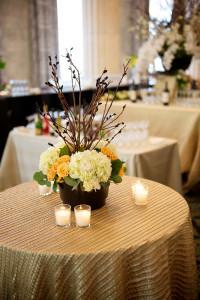 White & Orange Flower Arrangement on Table