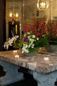 Orange, Purple & White Flowers on Marble Countertop