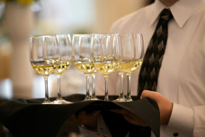 Professional Waiter Holding Wine Glasses