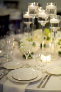 Place Setting with wine Glasses, Candles, Green Flowers
