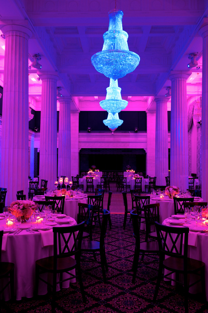Several Tables with Dramatic Pink, Purple & Blue Lighting and Chandeliers