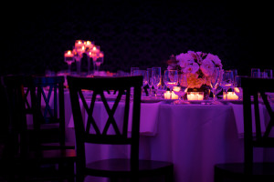 Dramatic Focus of Candles with Purple Lighting and Chair