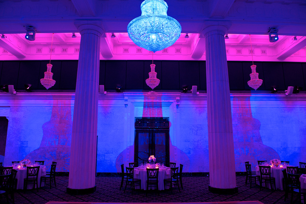 Bright Blue Chandelier with Backlit Purple & Pink Ballroom Architecture
