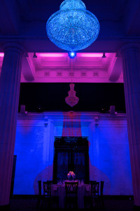 Bright Blue Chandelier with Backlit Pink and Purple Ballroom Architecture