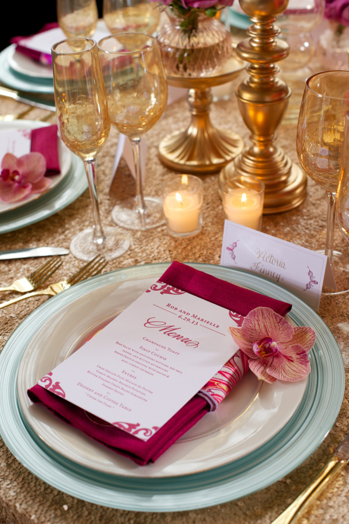 Detail of Pink and White Wedding Invite with Candles in Background