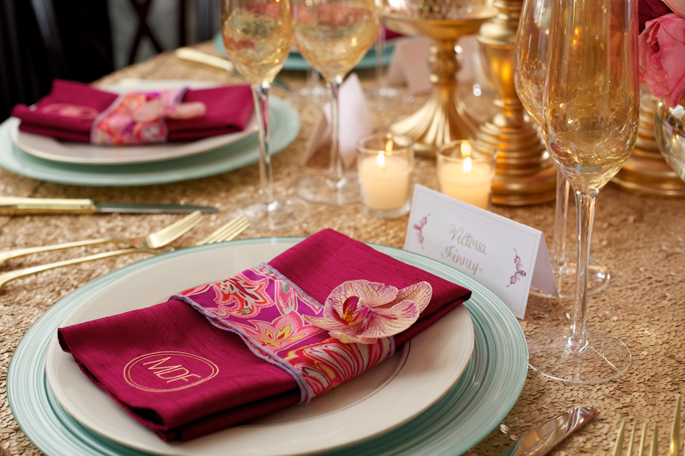 Closeup of Pink Napkin with Gold Decorations