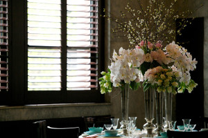 White and Pink Floral Arrangements on Table Near Open Window Shade