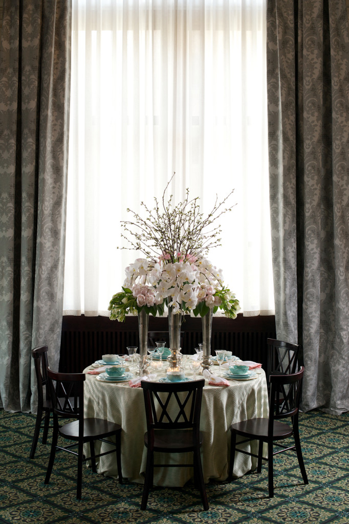 Full View of Table Setting with Pink and White Flowers, Blue Cups