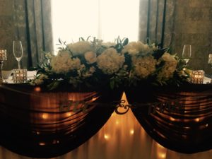 Floral Arrangement Wedding Decoration with Candles Backlit