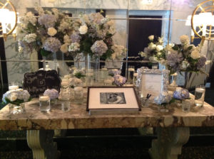 Floral Arrangement on Marble Table with Picture of Couple